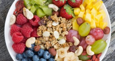 ingredients for a healthy breakfast in one dish on wooden background, top view