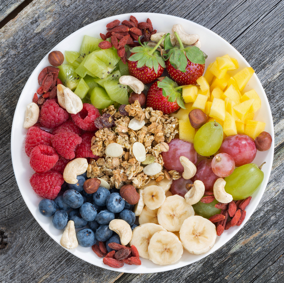 ingredients for a healthy breakfast with dietary fiber in one dish on wooden background, top view