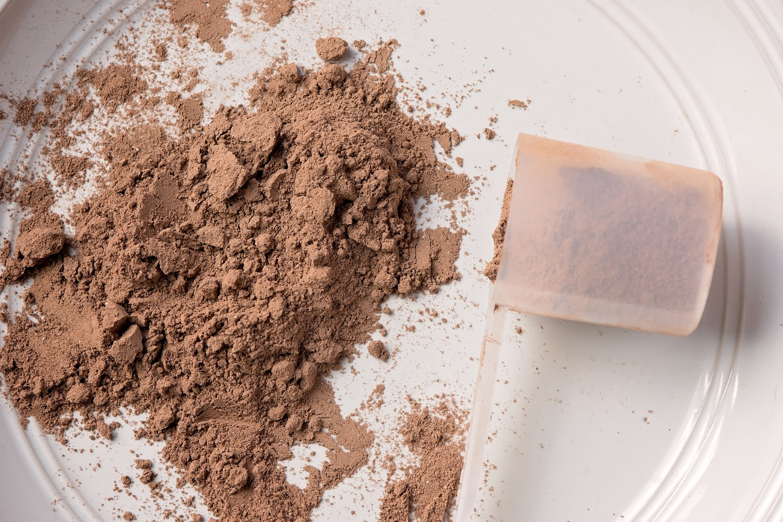 Meal replacement shake powder on a plate with scoop