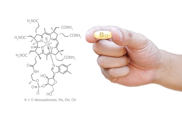 vitamin B12 held in hand