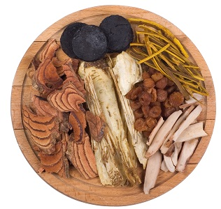 Chinese herbs on wooden plate