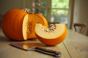 Cutting a Slice of Pumpkin in a Kitchen