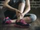 her ankle injured in gym fitness exercise training, healthy