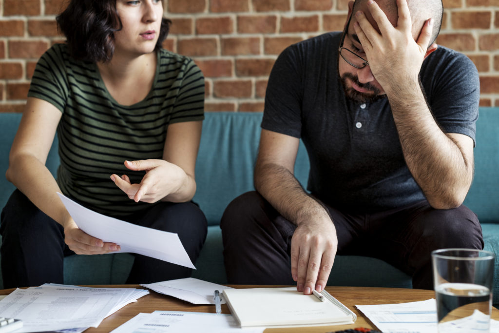 married couple stressed out because of finances